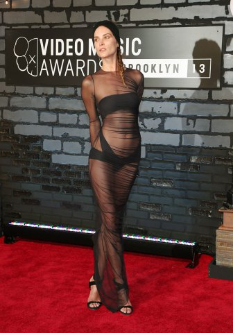 Model Erin Wasson poses on arrival for the 2013 MTV Video Music Awards in New York